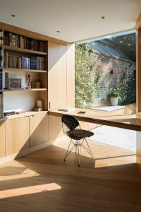 light filled home office frameless structural glass wall