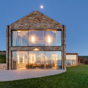 Double height glass facade to maximise natural light and views of the coast