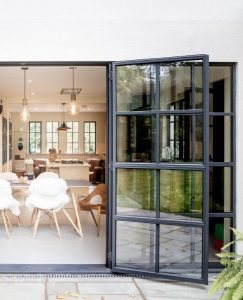 Steel French doors with glazing bar designs and flush threshold